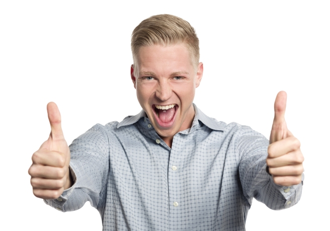 Fantastic job: Excited young businessman giving thumbs up while